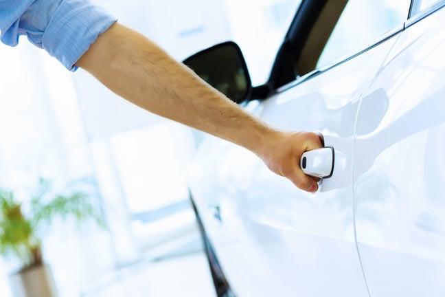 Close up human hand opening car door